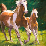 Painting of two spotted horses running free