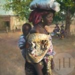 African mother carrying her child on her back